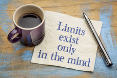 Limits exist only in the mind. Inspirational handwriting on a napkin with a cup of espresso coffee stock photos