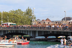 Limmat river and Quaubruecke bridge during the Street Parade Royalty Free Stock Photo