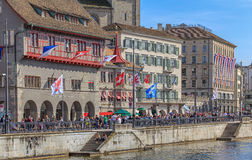 Limmatquai quay in Zurich with buildings decorated with flags Stock Photo
