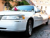 Limo. White limo, ornated with flowers; wedding limousine