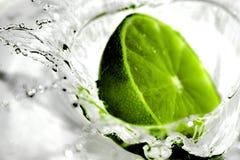 Limão com água Imagem de Stock Royalty Free