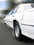 Limo Passing By. A limo passing by with motion blur Stock Photography
