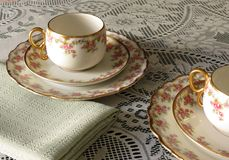 Limoges China. Limoges Bridal Wreath cups and saucers and small plates for afternoon tea stock photography