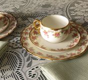 Limoges China. Limoges Bridal Wreath cups and saucers and small plates for afternoon tea royalty free stock photography