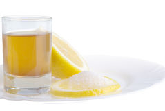 Limon on a plate. Limon with sugar on the white plat and a wine-glass of congac Royalty Free Stock Photography