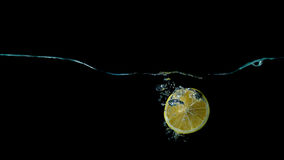 Limon in water splash. Sparkling, slice, refreshing stock images
