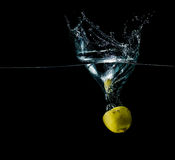 Limon in water splash. Sparkling, slice, refreshing isolated stock photos