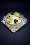 Limoncello cake. At the withe rosette plate Royalty Free Stock Images
