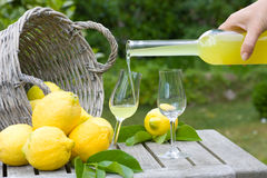 Limoncello and lemons Royalty Free Stock Images