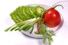 Limone amaro, pomodoro, aneto, peperoncini rossi e cipolla verde della sorgente Fotografie Stock
