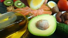 Limone, antiossidante organico del pesce rosso dell'avocado dell'acqua stock footage