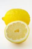 Limone isolato e una metà Immagini Stock Libere da Diritti