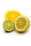 Limone, limetta e un taglio arancione Immagine Stock