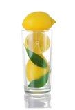 Limones en un vidrio Fotos de archivo libres de regalías