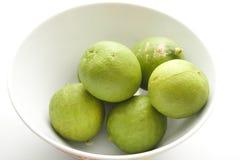 Limones verdes Imagenes de archivo
