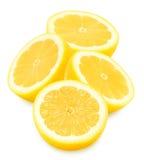 Limoni gialli succosi su un fondo bianco isolato Fotografia Stock Libera da Diritti