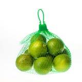 Limoni nella rete verde Fotografia Stock