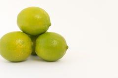 Limoni su priorità bassa bianca Immagine Stock