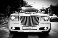 Limousine. White wedding limousine on the streets of the city Royalty Free Stock Photography