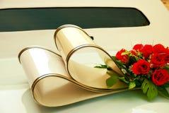 Limousine backside ornate with flowers. White wedding retro car closeup. Yellow toned. Royalty Free Stock Photos
