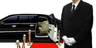 Limousine chauffeur standing by the car Stock Photo