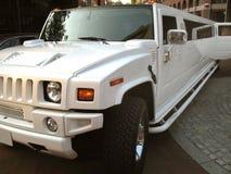 Limousine del Hummer di stirata Immagini Stock