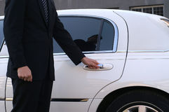 Limousine driver. Is opening car door for client Royalty Free Stock Photography