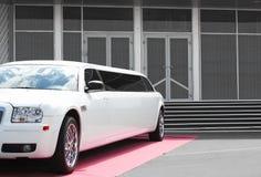 Limousine near office building. White limousine near office building Stock Photos