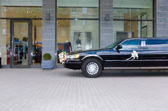 Limousine near the shop Stock Photography