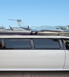 Limousine and private jet Royalty Free Stock Photo