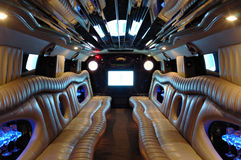 Limousine salon. Salon of limousine with laser light and TV screen Stock Photography