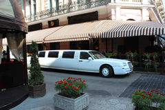 Limousine standing besides caffe in Lvov Royalty Free Stock Images