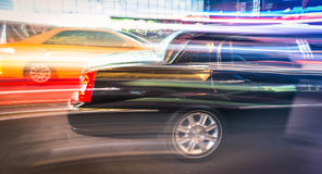 Limousine and taxi speeding in New York City Royalty Free Stock Image