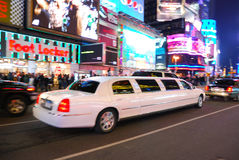 Limousine in Times Square, New York City. With busy traffic and commercial billboard at night royalty free stock images
