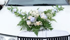 Limousine with wedding bouquet. Royalty Free Stock Images