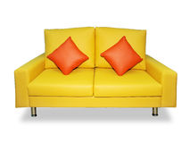 Limpe o sofá e descansos amarelos Foto de Stock Royalty Free