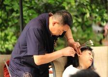 Limpeza da cera de orelha em Chendu China Fotografia de Stock Royalty Free