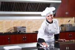 Limpeza do cozinheiro chefe Foto de Stock