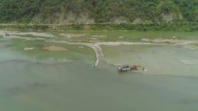 Limpeza e aprofundamento por uma draga no rio Filipinas, Luzon filme