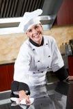 Limpeza fêmea do cozinheiro chefe Foto de Stock Royalty Free