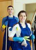 Limpiadores con el equipo listo para el trabajo Foto de archivo libre de regalías