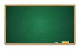 Limpie al consejo escolar con tiza y la esponja Foto de archivo