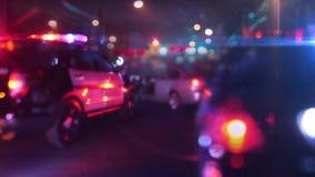 Limpie el coche patrulla en la escena del defocus de la lente óptica de la emergencia almacen de video