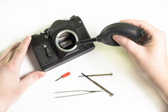 Limpieza de la cámara vieja Imágenes de archivo libres de regalías