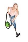 Limpieza de la mujer con el aspirador imagen de archivo libre de regalías