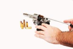 Limpieza de una pistola Foto de archivo libre de regalías