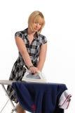 Limpieza y el presionar del ama de casa Fotos de archivo