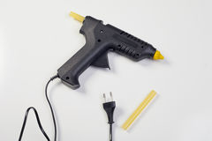 limvapnet med löstagbart lim klibbar på en vit bakgrund arkivfoton