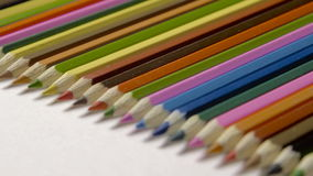 Lin of colour pencils isolated on white background close up stock video