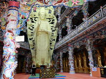 The Lin Phuoc pagoda in the Vietnamese city of Dalat. In one of the halls of the pagoda reigns, sculpture of the goddess of mercy, Guan Yin made from jade Royalty Free Stock Photo